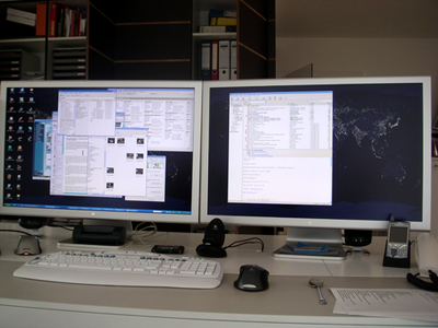 Two 30-inch Apple Cinema Displays connected to a PC in Dual-Screen mode. Wow.